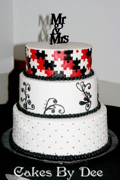 I like the top part! that could be the whole cake design! Puzzle Piece Wedding Cake