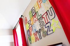"""I love the nail & string art. Its a great take on the traditional alphabet art that I've seen in kids' rooms. The room is spectacular. """"Jude's Nautical Big Boy Room."""" Found on Apartment Therapy."""