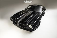 1970 Pontiac Firebird: a heavily modded '70 Pontiac Formula Firebird made by All Speed Customs for Tom Conkright. It has a 1200hp engine with a twin-turbo system, a full leather interior and a sweet glossy black paint.