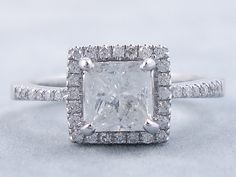 This is our beautiful 1.19 ctw Princess Cut Diamond Engagement Ring. It has a slightly 1.01 carats Princess Cut Center Diamond that is G Color/SI3 Clarity, Clarity Enhanced (Fracture Filled and Laser Drilled) Center Diamond. It is set in 14K White Gold and listed for $1,990. Diamond Girl, Princess Cut Diamonds, Diamond Are A Girls Best Friend, Beautiful Rings, Diamond Engagement Rings, Diamond Jewelry, Halo, Clarity, Soup
