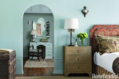 The guest-room colors have a Moroccan flavor. Walls are painted in Benjamin Moore's Wythe Blue. The headboard is covered in Hanover and pillows in Balerno, both by Pindler. Chest, Horchow.   - HouseBeautiful.com