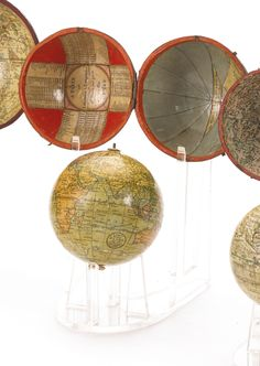 Sotheby's currently has auctions for several beautiful pocket globes from the 1790s and early 1800s. If you have a few grand lying around, one of these 2.5-inch to 3.5-inch beauties could be yours.