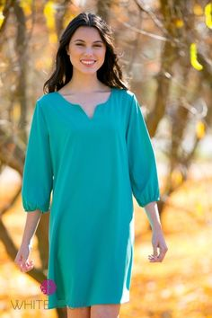 Look and feel great in the Martina Tunic Dress! This year-round essential has a relaxed fit, ¾ elasticized sleeves and a feminine notch neck detail. Designed to be worn on its own in summer or with leggings for colder weather. Style with solid or print leggings and boots for a flattering winter outfit!Colors AvailableMustardWineNavyBlackPlumTealFuchsiaJadeSizes AvailableSmall (0-4)Medium (6-8)Large (10-12)XL (14-16)Women's Sizing&nb...