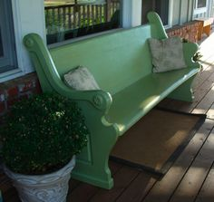 church pew painted happy green w/ throw pillows