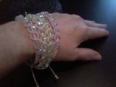 Bracelet with svarovski in pink and yellow.