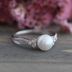 Vintage Inspired Pearl Engagement Ring in 10k White Gold 3 Stone Diamond Ring June Birthstone Ring Round Cut Gemstone Size 7 (Resizable) by LuxCrown on Etsy https://www.etsy.com/listing/279918432/vintage-inspired-pearl-engagement-ring