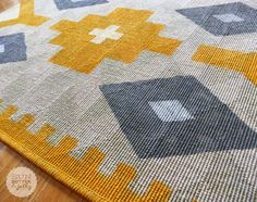 This is a tightly woven rug from IKEA with a taped off then painted Kilim pattern. Yet another inspirational creation!