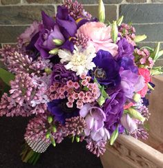 Lovely Bridal Bouquet. Using Anenome, Lizianthus, Lilacs, Ranunculus, Freesia, Spray Roses, and more!