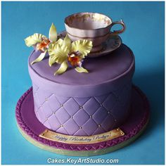 Lilac Teacup and Yellow Orchids Cake  by Cakes.KeyArtStudio.com, via Flickr