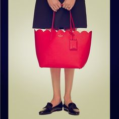 Brand new Kate spade bag red tote trendy tulip This bag is all the rage. Tulip like minimalistic statement. Looks great with any beach wear or summer dress. Compliments are in order. The pink interior is enough to brighten anyone's day. kate spade Bags Totes