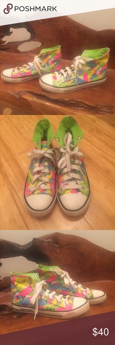 RARE Neon High tops by Rocket Dog Size 7 RARE Neon Patterned High tops by Rocketdog. Size 7. Gently worn. This is a rare model not made anymore and hard to find. Very unique shoes! In good condition with normal signs of a gently worn shoe (there's a little black on the laces and the white ends have some minor markings.) Nothing major. Still look great and have tons of life left! Rocket Dog Shoes Sneakers