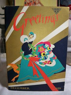 Art Deco  December 1928  Buzza Greetings trade book Colorfully dressed Flapper with christmas wreath Large Deco dog on Leash gold gilded