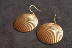 Brass Art Deco earrings, Brass disk earrings, Brass earrings, Brass Scallop earrings, Gold plated sterling silver ear hooks. by debohun on Etsy https://www.etsy.com/uk/listing/505633640/brass-art-deco-earrings-brass-disk