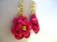 Cute little handmade vintage macrame earrings in pink with gold color beads in the middle. The dangle earrings are made by a special Chinese knotting art that involves with one satin nylon cord to create the flower knot design.  Each earring measures a little less than 3/4 inches long and 3/4 i...