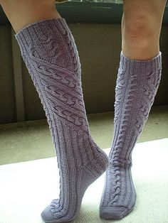 Cables flow in interesting directions on these knee-highs. Free - Ravelry: Project Gallery for Treetop Socks pattern by Heidi M. Scheppmann