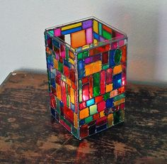 This would be pretty on a patio table near a firepit this fall. Learn how to make a Faux Stained Glass Mosaic Luminary from Crafts by Amanda #StainedGlassHowToMake
