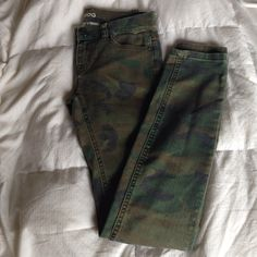 Camo cigarette leg jeans Washed out camo print jeans . In great condition .. Wore these about two times. Size 24 BDG Jeans Ankle & Cropped