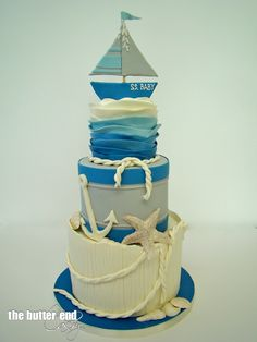 "This is a nautical themed baby shower cake by The Butter End Cakery but this concept is a cute idea for a nautical or beach wedding cake. Could put the couple's last name as the boat name, as in ""SS CoupleName"""