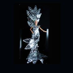 The sparkle on this over the top fantasy mermaid doll in her mirror dress and headpiece is so over the top that you can only imagine it from the photos. Blinding light from every angle and on all sides, this dramatic large ( hand beaded pearl Wedding Dress is something to behold. She is dramatic and over the top all the way to her arms that are outstretched to say  look at me, I am fabulous ( 20 tall with headdress ) She is as flamboyant as they come. Large Rhinestone flowers are on her…