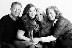 Lino Lakes family photographer. Family portrait session with teens and young adult children. Family of four. Studio black and white photos.
