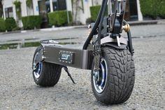 This WePed GT with its machined aluminum construction and carbon fiber accents, is the best-built electric scooter we've ever tested. Electric Bicycle, Electric Scooter, Electric Motor, Thunder Vs, Kart Racing, Terrain Vehicle, Street Performance, Heavy Rubber, E Scooter