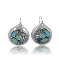 Relish in the sophisticated design of these gorgeous sterling silver earrings with soft and feminine shades of green and blue. With sparkling Swarovski crystals and pretty white beading, these eye-catching earrings are sure to dazzle. You'll look elegant and chic wearing these pretty gems to work or for weekend gatherings. These versatile earrings are ideal for any occasion.