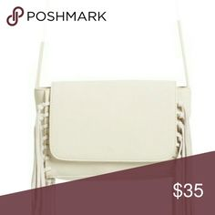 "Nwt! Street Level Foldover Fringe Crossbody Bag Nwt! Street Level Foldover Fringe Crossbody Bag   Boho-chic style Crossbody Bag   -color is Ivory -Foldover Magnetic Snap-Flap Closure -textured faux leather with real suede fringe -interior Zip compartment -8"" width and 6 1/2"" height -comes with dust bag -22"" Crossbody strap drop Street Level Bags"