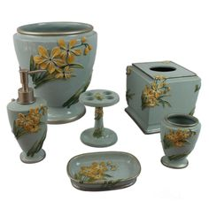 This beautiful floral bath accessories set will turn a bland bathroom into a tranquil getaway youll love to be in. The soft blue and green colors and cheerful raised yellow flowers are showcased on these six essential resin bathroom accessories.