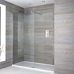 Recessed walk in shower with round chrome shower head and arm, glass screen, and black shower tray Bathroom Shop, Big Bathrooms, Small Bathroom, Bathroom Bin, Concrete Bathroom, Luxury Bathrooms, Contemporary Bathrooms, Bathroom Towels, Bathroom Faucets