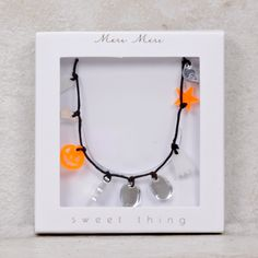 Dangle these spooky charms around your neck for a specially creepy Halloween. The necklace comes with ghost, moon, pumpkin, star and letter charms spelling out BOO!