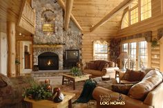 Log Home By Golden Eagle Log Homes - golden eagle log logs cabin home homes house houses rustic knotty pine custom design designs designer floor plan plans kit kits building luxury built builder complete package packages interior picture of popular model home in wisconsin open to the public daily free tours gas fireplace with stone exterior well appointed furnishings