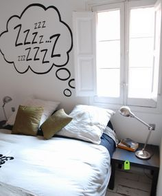 Comic book style. Life imitates pop art with this nod to comic book thought bubbles. This charming painting is so much more fun than a traditional headboard, and it deftly expresses a free-spirited inclination as light and fresh as the feather-white walls and bedding.