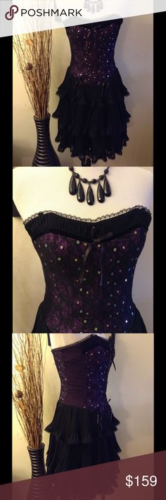 """Purple Black Lace Sequin Corset Tiered Dress BETSEY JOHNSON EVENING Purple Black Lace Sequin Corset Ruffle Tiered Mini Dress  Size 6  DESCRIPTION: Strapless Corset - Sequined with Purple Lace Skirt - Ruffled and Tiered Tulle Lined Back Mesh Fish Hook Closure  MEASUREMENTS/SIZE: Size 6 Bust: 29"""" Waist: 26"""" Length: 31""""  MATERIAL: Shell 1: 100% Poly Chiffon Shell 2: 100% Nylon Shell 3: 100% Polyester Lining: 100% Acetate Betsey Johnson Dresses Prom"""