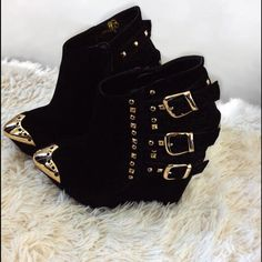 Cleopatra Nova Ankle Boot, Sz 7 Super cute black ankle boot with gold tone toe, studs and buckles. Worn a few times for photo shoot and fashion show. Great condition. Size 7 Cleopatra Shoes Ankle Boots & Booties