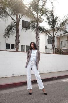 storm wears acne studios white t-shirt with dolce vita black mules &other stories white jeans