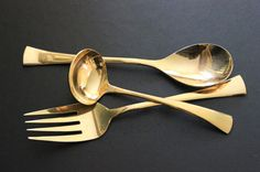 Like jewelry fro your table. Gold plated serving spoon, ladle and fork, server flatware. $38.00, via Etsy.