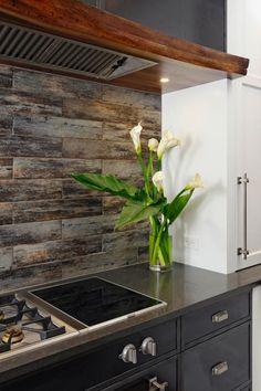 HGTV showcases a ceramic tile backsplash that looks like weathered wood in this neutral modern kitchen.