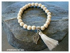 Check out this item in my Etsy shop https://www.etsy.com/uk/listing/253929966/cream-turquoise-leaf-tassel-bracelet