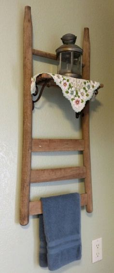 Hand towel rack made from an old chair.   I used the rungs from it to make the shelf.