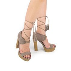 Step up any outfit with these wooden block high heels. Show those legs with a lace up, side slit maxi dress. #trending #bohemianstyle #laceupheels #laceups #trendy #trending #fashionista #newarrivals #taupe #fashion #boho #woodenheel #spring #summer #cuteheels