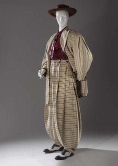 Zoot-suits were worn by lower class Mexican and African Americans in the 1940s. It had a very loose and long pants with an extremely large jacket. The suit to express t individuality and feelings of rebellion. People saw wearing the zoot-suit as a deliberate, public, and obnoxious way of ignoring the rationing/war effort after the War Production Board nearly banned the production of them. also a lot of Zoot-suits were worn by jazz players. They can be seen in 1970s and modern day as well.