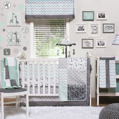 The Peanut Shell Uptown Giraffe 4 Piece Crib Set.  Contemporary neutral collection with textured chevron; Mint and Grey are trending colors for boys and girls; It pairs trend forward chevrons with simple geometric prints for a clean and simple gender neutral option; The palette of mint and gray is on pace with current color trends as seen on Pinterest and Polyvore .