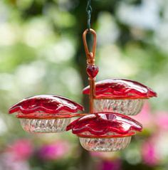 Charming 3-in-1 feeder keeps up to three hummingbirds happily fed at once.