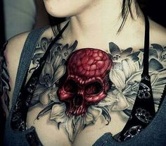 We enjoy the devilish looking crimson skull in this piece. #InkedMagazine #red #skull #chest #tattoo #tattoos #inked #floral #flowers #fabiankreher