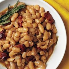 Beer-Baked White Beans (link isn't working so here it is) http://www.delish.com/recipes/cooking-recipes/cooking-with-beer-mslo0810#slide-8