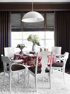 Paint and upholster eclectic dining chairs for a cohesive, whimsical look.