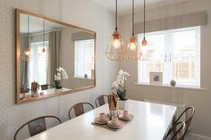 This copper lighting in the open plan living/dining room definitely makes a statement at #MeonVale. Don't you agree?