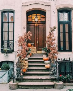 Front steps are the perfect place to place pumpkins and other fall goodies