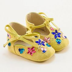Handmade yellow (mustard shade) leather baby shoes. Adorned with a colorful array of hand-sewn crystals and beads. Fully lined in leather. Soft leather