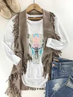 Suede Fringe Vest. Western vibes. Rodeo style. Skull tee. Pastel. Winter fashion. Boutique style. therollinj.com